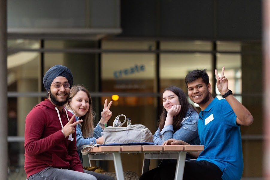 Four UBC Okanagan Students sitting at a picnic table during Create Orientation Day